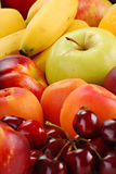 Composition with fruits. Including: apple, banana, cherries, apricots Royalty Free Stock Photography