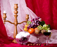 Composition with fruits, candlestick and wine Royalty Free Stock Image