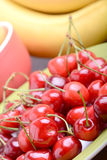 Composition with fruits cherry bananas apricot Royalty Free Stock Photo