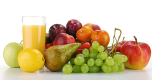 Composition with fruits and glass of orange juice. Isolated on white Royalty Free Stock Images