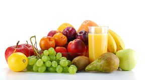 Composition with fruits and glass of orange juice. Isolated on white Royalty Free Stock Image