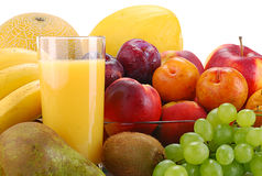 Composition with fruits and glass of orange juice. On white Stock Images