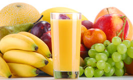 Composition with fruits and glass of orange juice. On white Royalty Free Stock Image