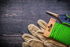 Composition of garden clippers tie wire safety gloves on vintage Royalty Free Stock Photo