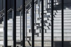 Composition with geometric structure of steps and metal balustra. Close-up photograph of abstract architecture fragment. Composition with geometric structure of Royalty Free Stock Image