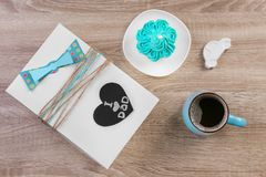Composition with gift box and cup of coffee. On wooden background. Father`s day celebration Stock Images