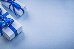 Composition of gift boxes on blue background holidays concept Royalty Free Stock Photo