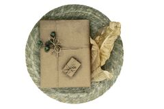 Composition of gift boxes wrapped in beige paper and bundled wit. H ribbons. Decorated with young oak acorns and dry leaves royalty free stock photos