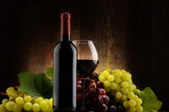 Composition with glass, bottle of red wine and fresh grapes Stock Photo
