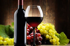 Composition with glass, bottle of red wine and fresh grapes Royalty Free Stock Photography