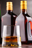 Composition with glass and bottles of hard liquor Royalty Free Stock Images