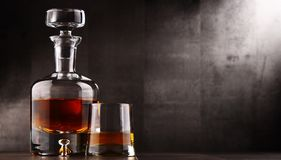 Composition with glass and carafe of hard liquor.  Royalty Free Stock Photography