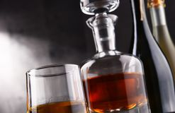 Composition with glass and carafe of hard liquor.  Stock Photo