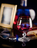 Composition with glass of cognac Royalty Free Stock Images
