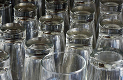 Composition with glass cups. AMPARO, SP, BRAZIL - FEBRUARY 9, 2016 - Cups of glass cheap in shelf of popular bar Royalty Free Stock Photography
