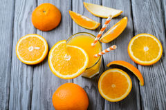 Composition with glass of orange juice and fruits Royalty Free Stock Photos