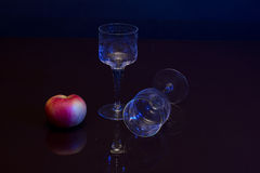 Composition with glasses and an apple Royalty Free Stock Image