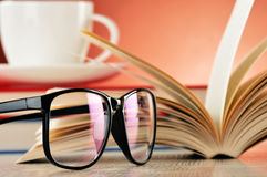 Composition with glasses and books on the table Stock Image