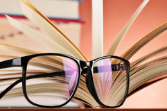 Composition with glasses and books on the table Royalty Free Stock Photo