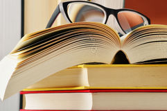 Composition with glasses and books on the table Royalty Free Stock Photos