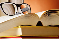 Composition with glasses and books on the table Royalty Free Stock Photography