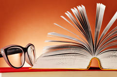 Composition with glasses and books on the table Royalty Free Stock Image