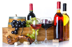 Composition with glasses and bottles of wine, a cask, corks, a c. Orkscrew and a wooden box, isolated on white stock image