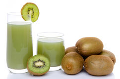 Composition with glasses of kiwi juice and fresh kiwis. Isolated on white stock photography