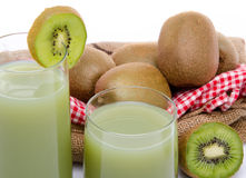 Composition with glasses of kiwi juice and fresh kiwis. Isolated on white royalty free stock photos