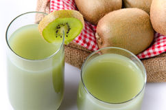 Composition with glasses of kiwi juice and fresh kiwis. Isolated on white royalty free stock images