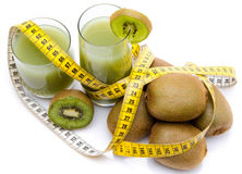 Composition with glasses of kiwi juice, fresh kiwis and a tape m. Easure, isolated on white stock photography