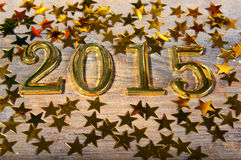 Composition of golden numbers 2015 year and gold asteri Stock Image