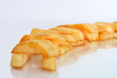 Composition of golden oven baked chips close-up stock photography