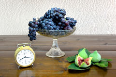 Composition with grapes and figs Stock Photos
