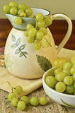 Composition of  grapes, a pitcher and a bowl Royalty Free Stock Photo