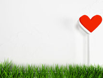 Composition with grass and heart Stock Photos