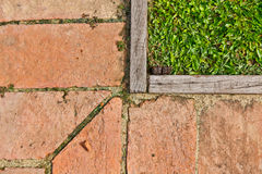 The Composition of grass, wood, and floor tiles Royalty Free Stock Photo