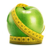 Composition with green apple and tape measure on white Royalty Free Stock Photo