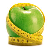 Composition with green apple and tape measure on white Royalty Free Stock Photos