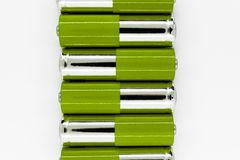 Composition of green and silver batteries placed in line and symbolize green energy, environment protection.  stock photos