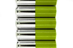 Composition of green and silver batteries placed in line and symbolize green energy, environment protection stock image