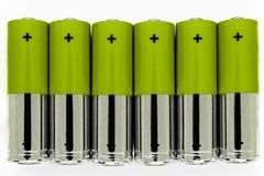 Composition of green and silver batteries placed in line and symbolize green energy, environment protection.  royalty free stock images