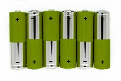 Composition of green and silver batteries placed in line and symbolize green energy, environment protection.  royalty free stock photography