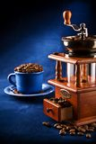 Composition of grinder and cup with coffee grain Stock Images
