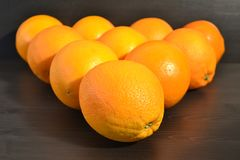 Composition of a group of ripe oranges in a shape of a triangle. stock images