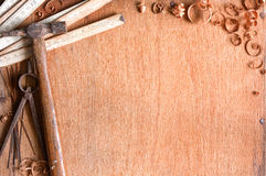 Composition of grundgy old hand tools. Composition of grungy old hand tools on wood texture with space for text stock photography