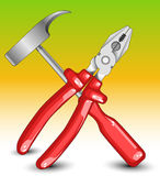 Composition from hammer and flat-nose pliers Stock Photography