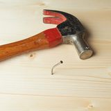 Composition of hammer and nail Royalty Free Stock Photography