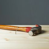 Composition of hammer and nail Royalty Free Stock Images