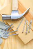 Composition of hammer and nails with glove closeup Royalty Free Stock Photos